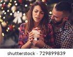boyfriend giving present as... | Shutterstock . vector #729899839