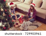 young family on christmas... | Shutterstock . vector #729903961
