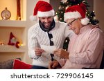smiling son and his elderly... | Shutterstock . vector #729906145