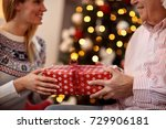 exchanging christmas gifts... | Shutterstock . vector #729906181