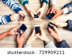 hands circle using phones on... | Shutterstock . vector #729909211