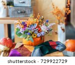 flower arrangement in pumpkin | Shutterstock . vector #729922729