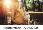 pregnant woman with her dog.... | Shutterstock . vector #729932335