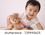 asian baby wearing white...   Shutterstock . vector #729945625