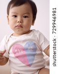 asian baby wearing white...   Shutterstock . vector #729946981