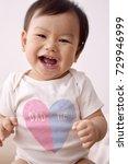 asian baby wearing white...   Shutterstock . vector #729946999
