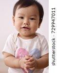 asian baby wearing white...   Shutterstock . vector #729947011