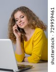 young woman with laptop on gray ...   Shutterstock . vector #729959461