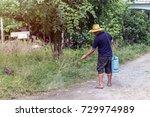asian man watering his garden.  ... | Shutterstock . vector #729974989