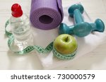 two dumbbells  bottle of water  ... | Shutterstock . vector #730000579