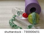 two dumbbells  bottle of water  ... | Shutterstock . vector #730000651