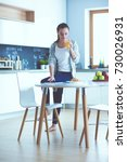 young woman with orange juice... | Shutterstock . vector #730026931