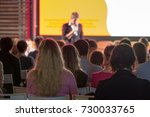 audience listens to the... | Shutterstock . vector #730033765
