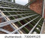 rood trusses under construction | Shutterstock . vector #730049125