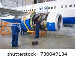 Stock photo replacing the engine on the airplane working people concept maintenance of aircraft 730049134