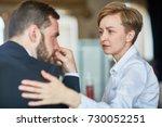 helpful colleague comforting... | Shutterstock . vector #730052251