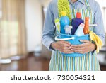 woman with cleaning equipment... | Shutterstock . vector #730054321