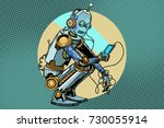 the robot sits and reads... | Shutterstock .eps vector #730055914