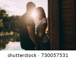 lovers at sunset. the... | Shutterstock . vector #730057531