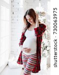 happy beautiful pregnant woman... | Shutterstock . vector #730063975