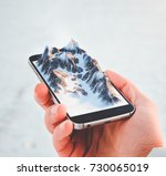 man holding smartphone with... | Shutterstock . vector #730065019