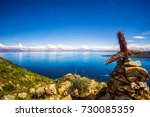 view on lake titicaca and cross ... | Shutterstock . vector #730085359