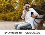 casual man listening music and... | Shutterstock . vector #730100101