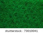 Green abrasive sponge texture background like grass - stock photo