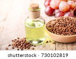 cold pressed grapeseed oil | Shutterstock . vector #730102819