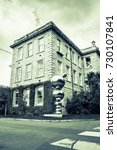 """Small photo of DUBLIN, IRELAND - AUGUST 9, 2017; Trinity College grounds, buildings and silver reflective sculpture """"Atoms and Apples"""" split toned image old-world effect August 9, 2017 Dublin, Ireland"""