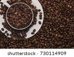 white cup with coffee beans.... | Shutterstock . vector #730114909