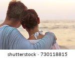 couple hugging on seashore | Shutterstock . vector #730118815
