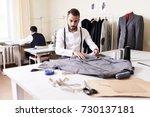 portrait of handsome tailor... | Shutterstock . vector #730137181