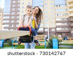 portrait of young mother... | Shutterstock . vector #730142767