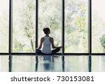woman meditating indoors. girl... | Shutterstock . vector #730153081