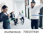 fun in the office. a man and a... | Shutterstock . vector #730157434