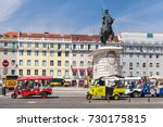 Small photo of Lisbon, Portugal - August 12, 2017: Tuk Tuk cabs of Lisbon stand on a city square with tourists as a passengers. Piaggio Ape three-wheeled light commercial vehicles