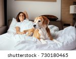 woman and her beagle dog meet...