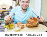 man eating knuckle of pork and... | Shutterstock . vector #730183285