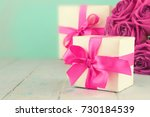 gift box with a pink bow and a... | Shutterstock . vector #730184539