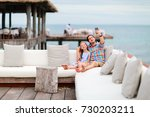 father and daughter relaxing in ... | Shutterstock . vector #730203211