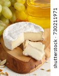 french camembert cheese with... | Shutterstock . vector #730211971