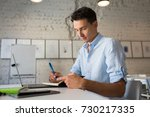 young handsome man sitting in... | Shutterstock . vector #730217335