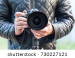 man hold photo camera. outdoor. | Shutterstock . vector #730227121