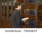 man holds a book in his hands... | Shutterstock . vector #73024819