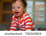 Portrait Of Cute Baby Boy With...