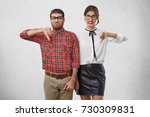unhappy couple of professional... | Shutterstock . vector #730309831