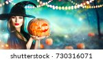 halloween witch with a carved... | Shutterstock . vector #730316071