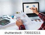 businessman analyzing... | Shutterstock . vector #730323211