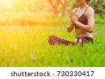 yoga in the park   Shutterstock . vector #730330417